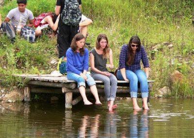 People enjoying pond